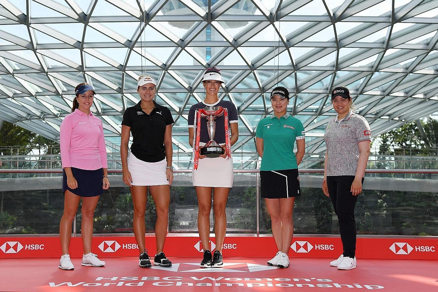 From far left: Georgia Hall, Lexi Thompson, defending champion Michelle Wie, Ryu So-yeon and world No. 1 Ariya Jutanugarn at Singapore's latest attraction - Jewel Changi Airport - before they get down to business at the HSBC Women's World Championshi