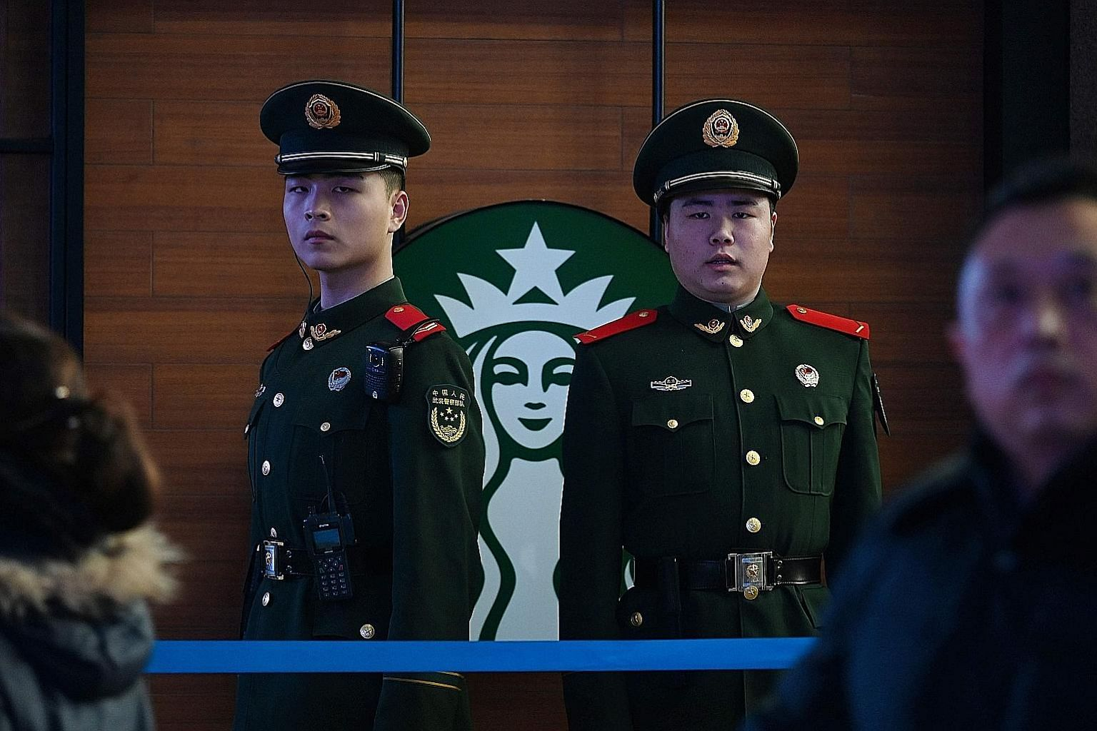 Outside Starbucks Coffee, an American chain, in Beijing. In its annual China Business Climate Survey report released yesterday, the American Chamber of Commerce in China noted that 30 per cent of 314 members surveyed said overall profitability fell l
