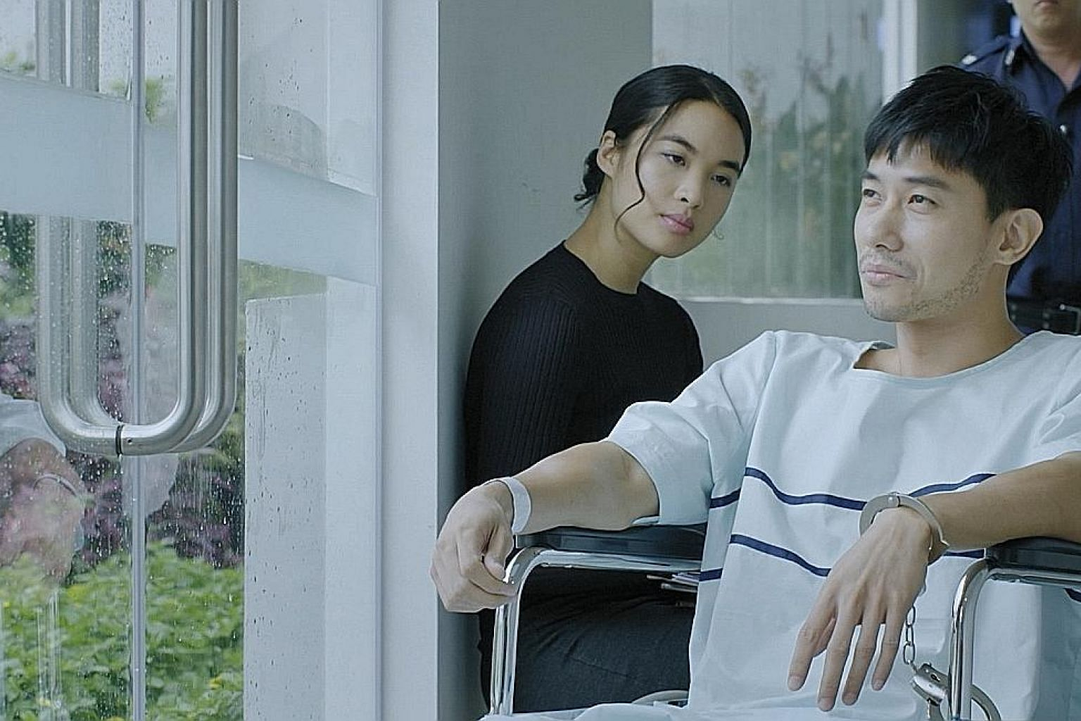 Netflix series Flavorful Origins features not only dishes, but also the people who prepare them. Actor Desmond Tan plays a serial killer, while Cheryl Chitty Tan (both left) plays his psychologist, in Toggle series Derek.