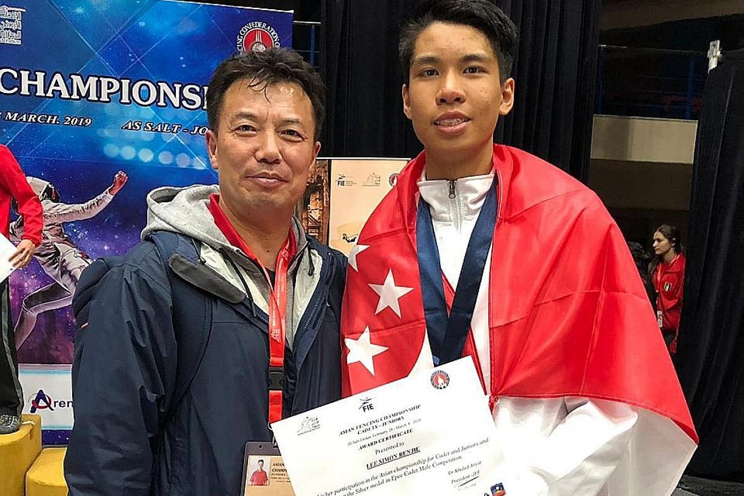Simon Lee with coach Shim Jae-sung after a superb run to the final, in which he lost to Japanese ninth seed Ryu Matsumoto. The 16-year-old fencer had upset three top-10 seeds in the earlier rounds.