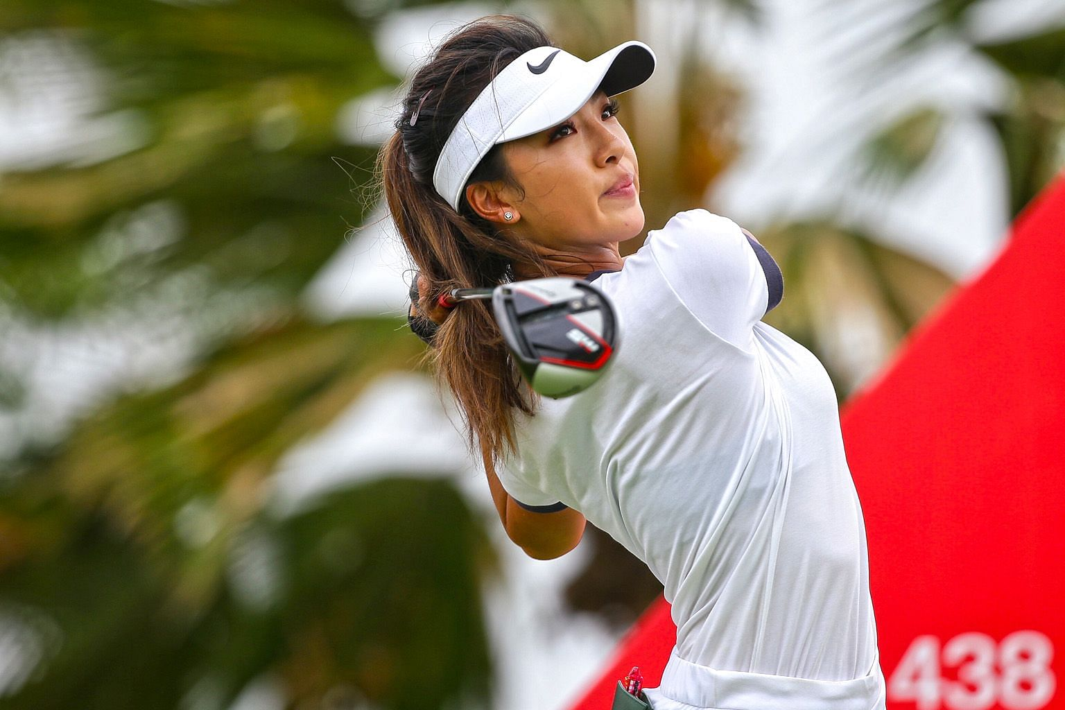 LPGA Tour rookie He Muni getting into the swing of things on the 12th hole during the first round of the HSBC Women's World Championship yesterday. She carded four-over 76 and finished tied for 51st. He having some time off in Pattaya, where she play
