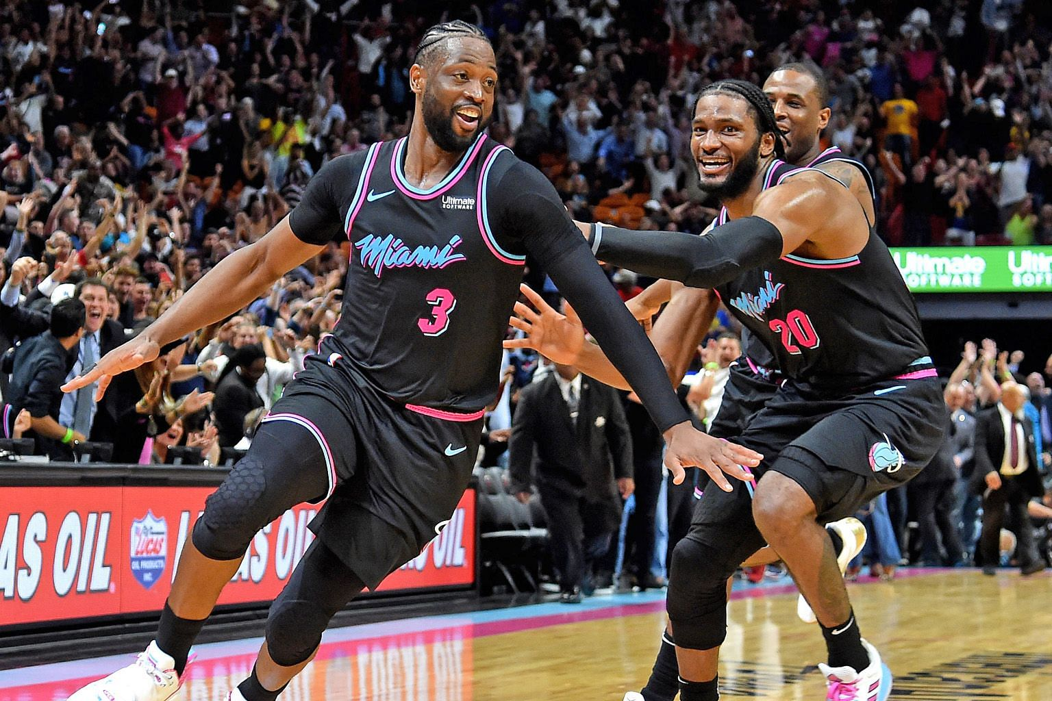 Miami Heat star Dwyane Wade (left) celebrating with Justise Winslow after making the game-winning basket against champions Golden State Warriors at American Airlines Arena.