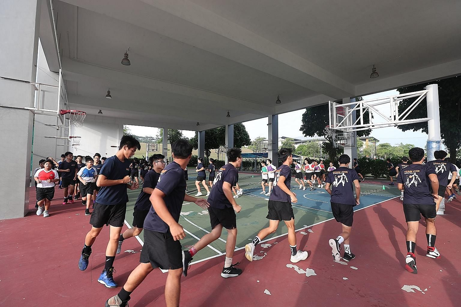The Christ Church Secondary School basketball team trains and the band holds rehearsals on Fridays, when textbooks are ditched for co-curricular activities. The school's four-day lesson week has been in place since 2010 and CCA attendance rates have