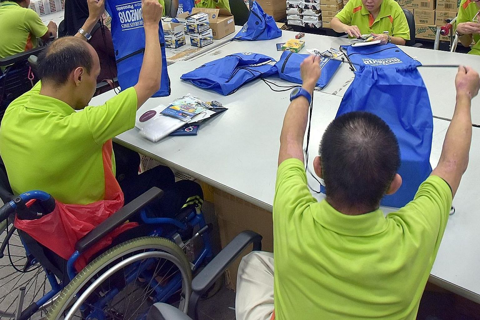 People from SPD, a charity for those with disabilities, packing bags for last year's ST Run. Ms Indranee Rajah said tertiary institutes help students with special needs build up their confidence and independence.