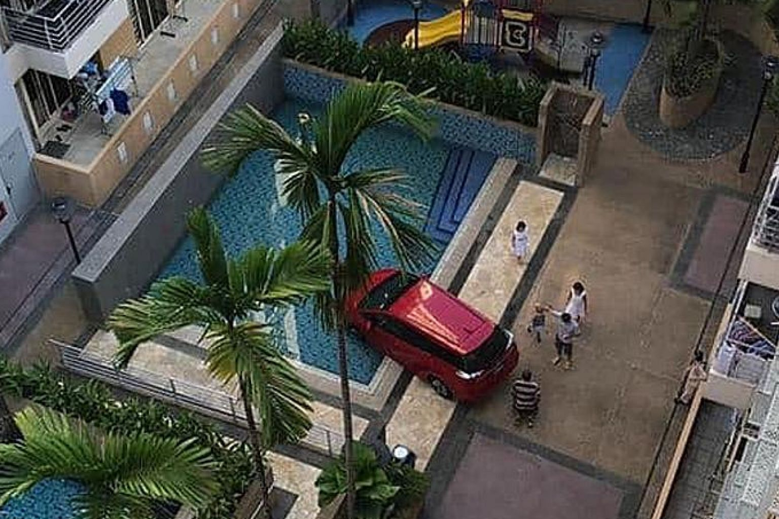 The red Honda Shuttle was reported to be a private-hire vehicle that had driven into the condominium compound on Sunday to pick up a passenger.