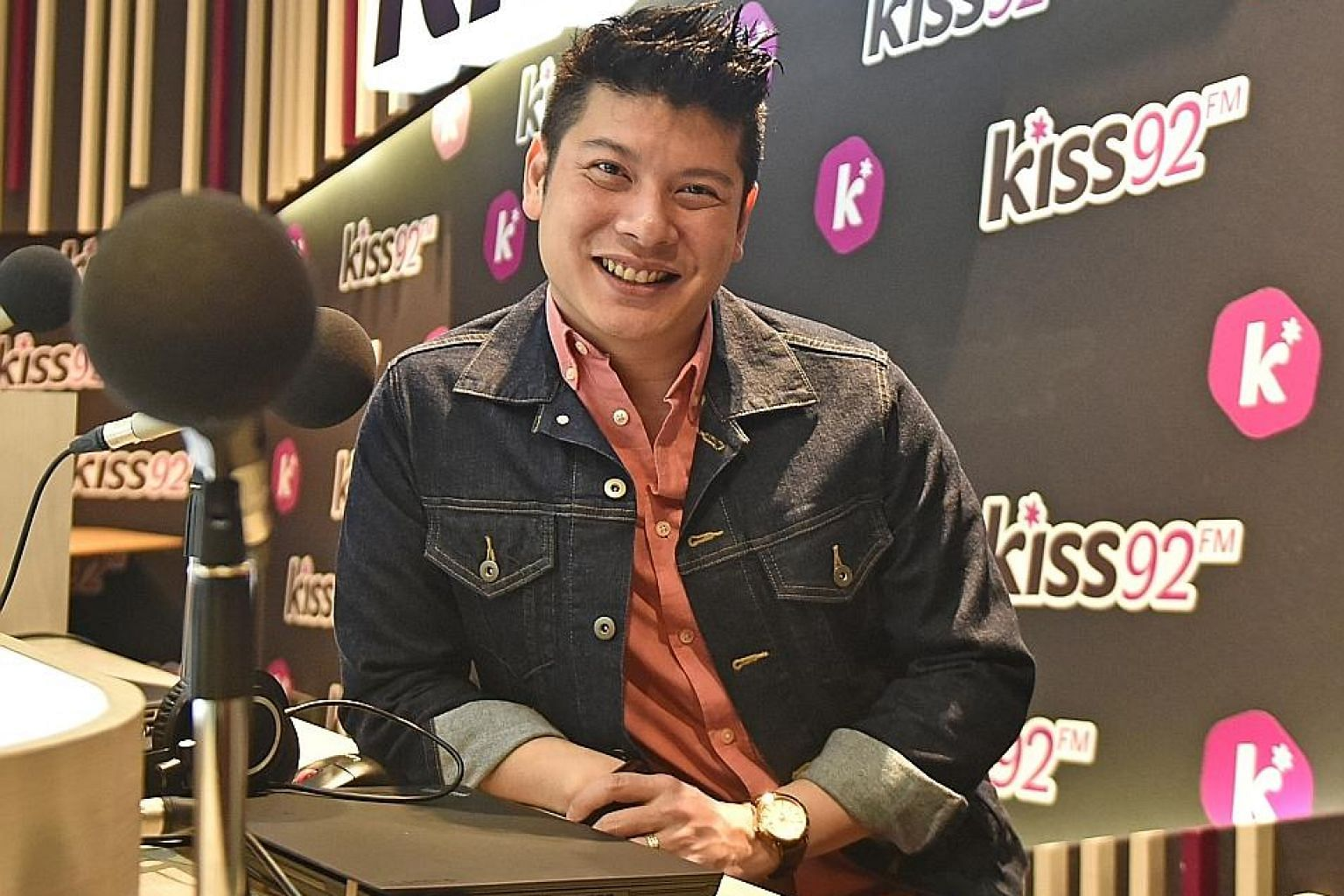 Radio DJ Tim Oh (above) helms the evening drive time show on Kiss92 with Carol Smith.