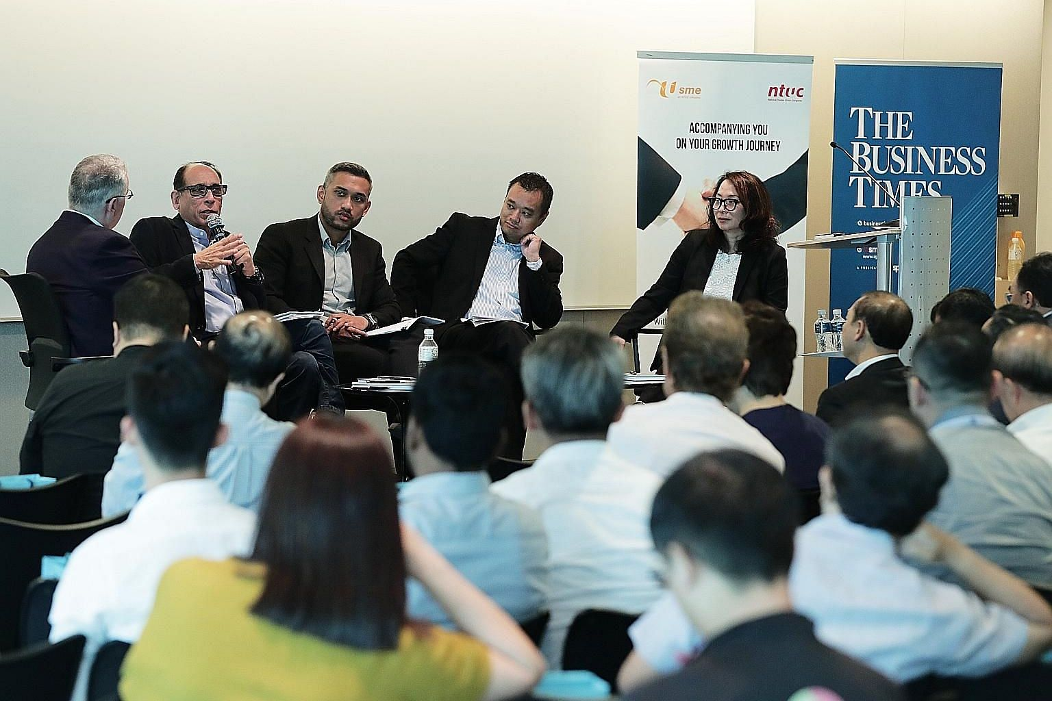 (From left) Singapore International Chamber of Commerce chief executive Victor Mills moderating the panel discussion, which featured The Straits Times' associate editor, Mr Vikram Khanna; Mr Ahmad Nazmi Idrus, a senior economist at RHB Investment Ban