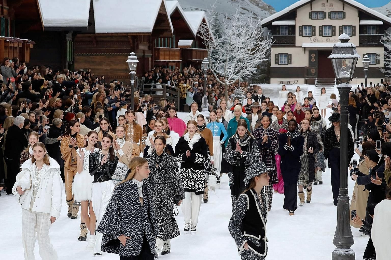 An over-the-top winter wonderland (left) was the backdrop for the Chanel show.