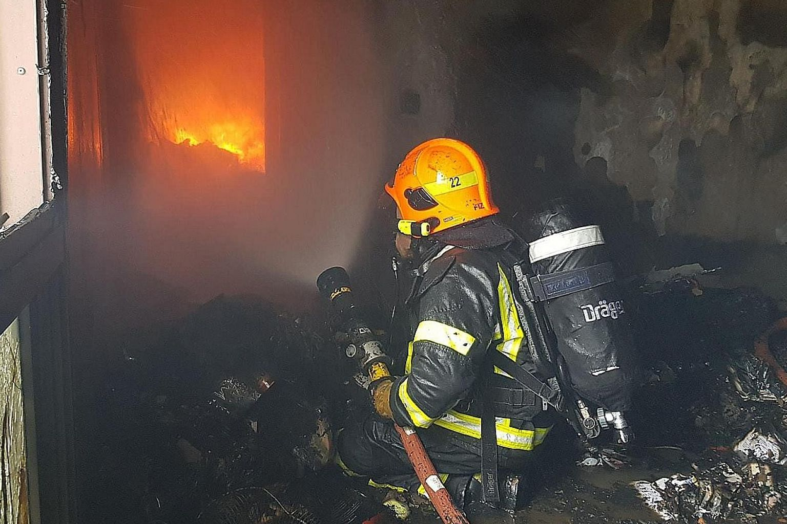Firefighters wearing breathing apparatus had to forcibly enter the flat. Fire had engulfed the entire unit due to the vast accumulation of combustible items inside, said the Singapore Civil Defence Force.