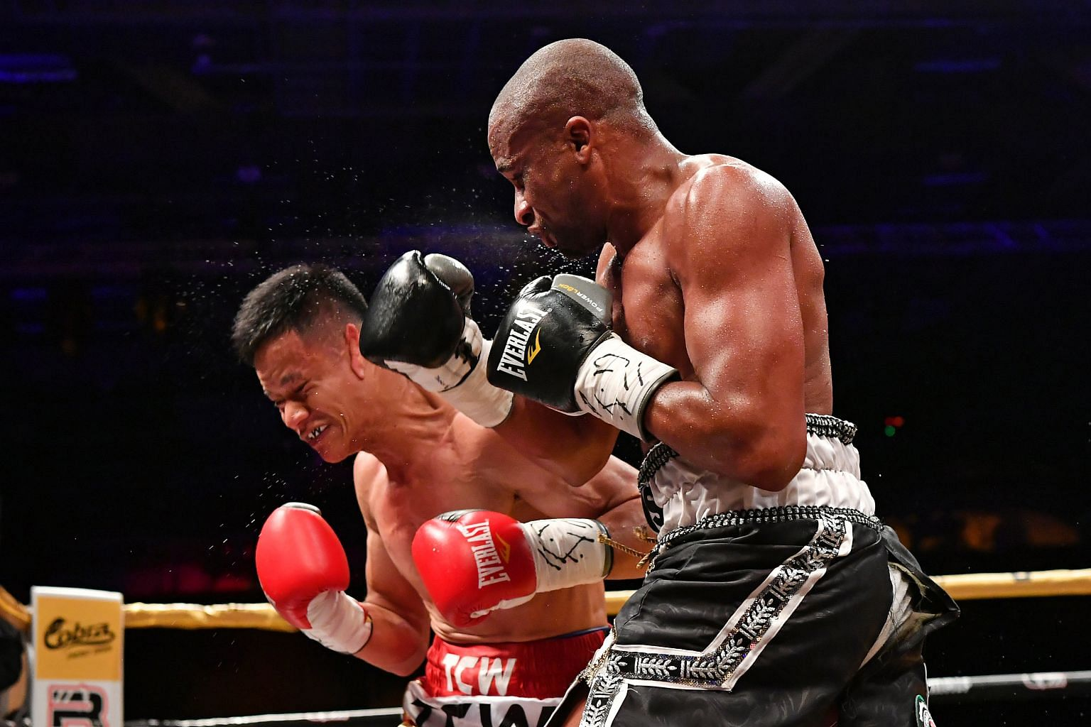 Muhamad Ridhwan taking a blow from Paulus Ambunda during their International Boxing Organisation super bantamweight world title bout last September. The Namibian won by a split decision, and the Singaporean will be keen to set the record straight whe