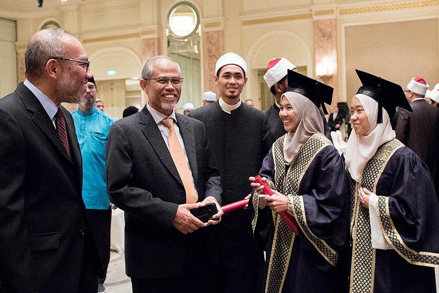 Minister-in-charge of Muslim Affairs Masagos Zulkifli with Singaporean students at Egypt's Al-Azhar University. Muis is stepping up efforts to engage overseas graduates and also introducing student liaison officers who will mentor the 800 Singaporean