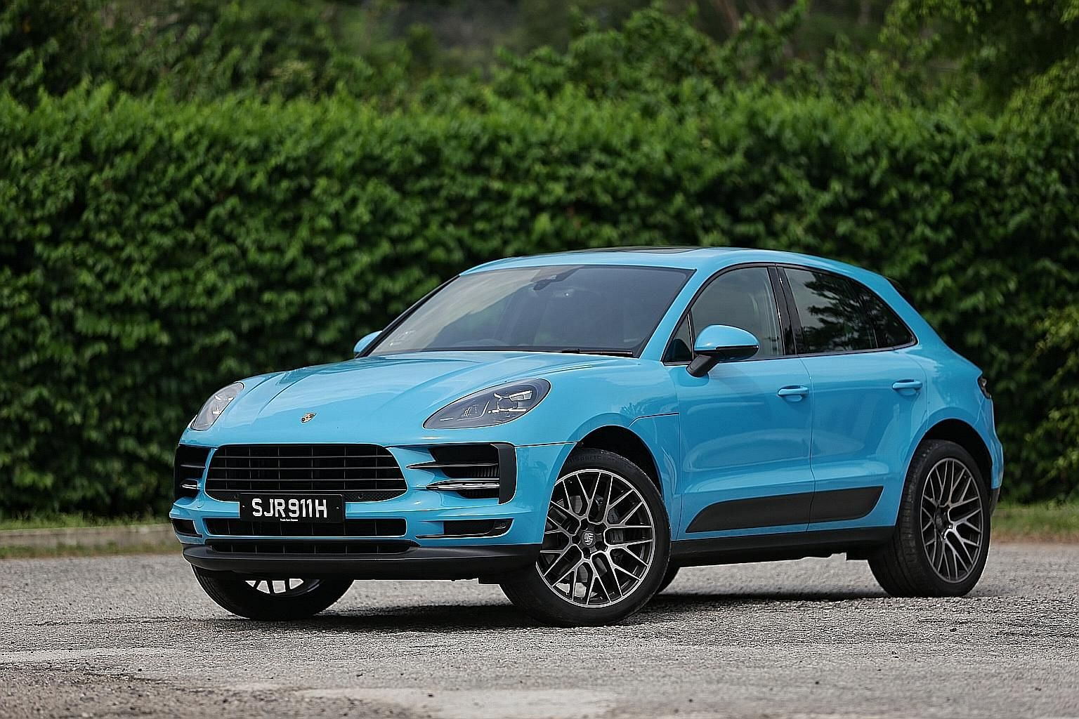 The facelifted Porsche Macan has a redesigned front bumper with wider side air intakes and LED headlights, and its tail lamps stretch across the width of the car.
