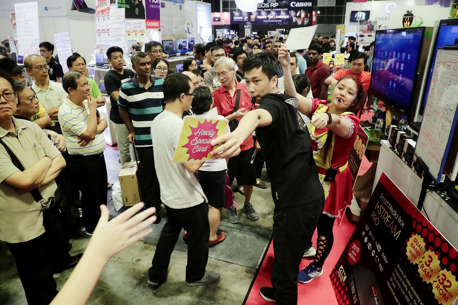 Limited hourly special cards being distributed to the crowd yesterday at the IT Show 2019, now on at the Suntec Singapore Convention and Exhibition Centre. The four-day consumer show, which is into its 18th year, is organised by Singapore Press Holdi