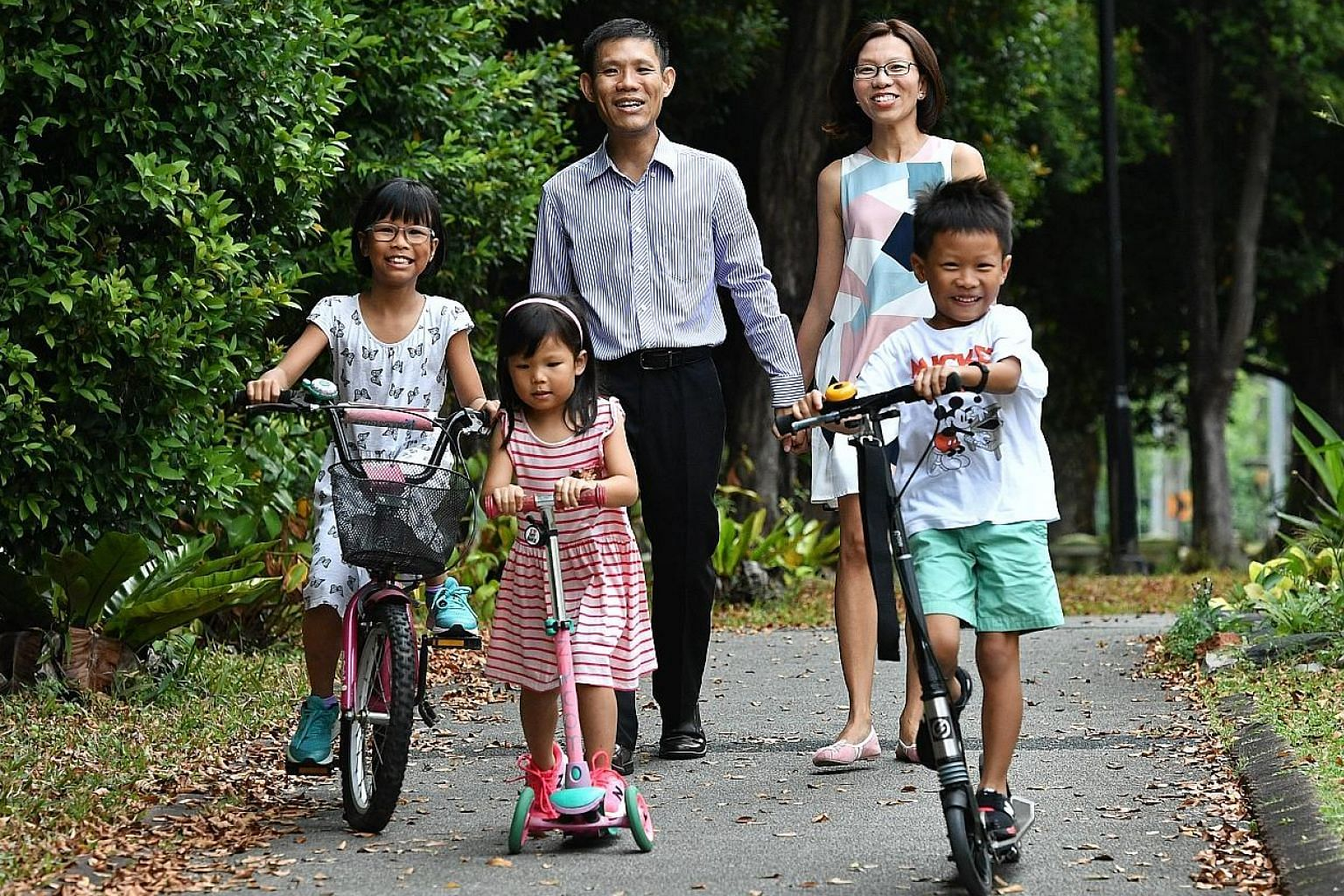 Financial services executive Derek Liang with his wife, Ms Lynne Tan, and their three children, Sarah (far left), Hannah and Joseph.