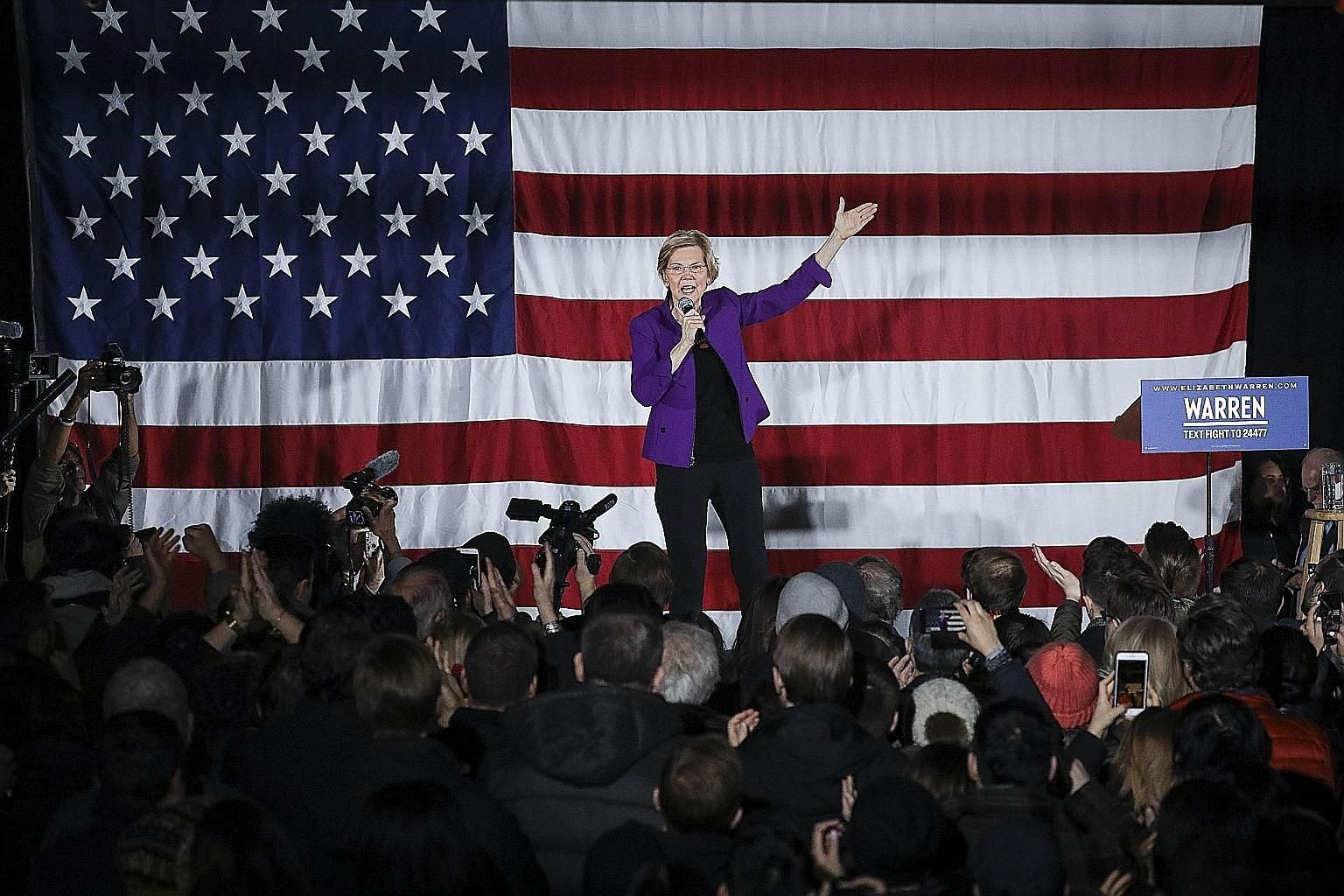 Democratic presidential hopeful Elizabeth Warren speaking before a crowd in Queens, New York City, on Friday.