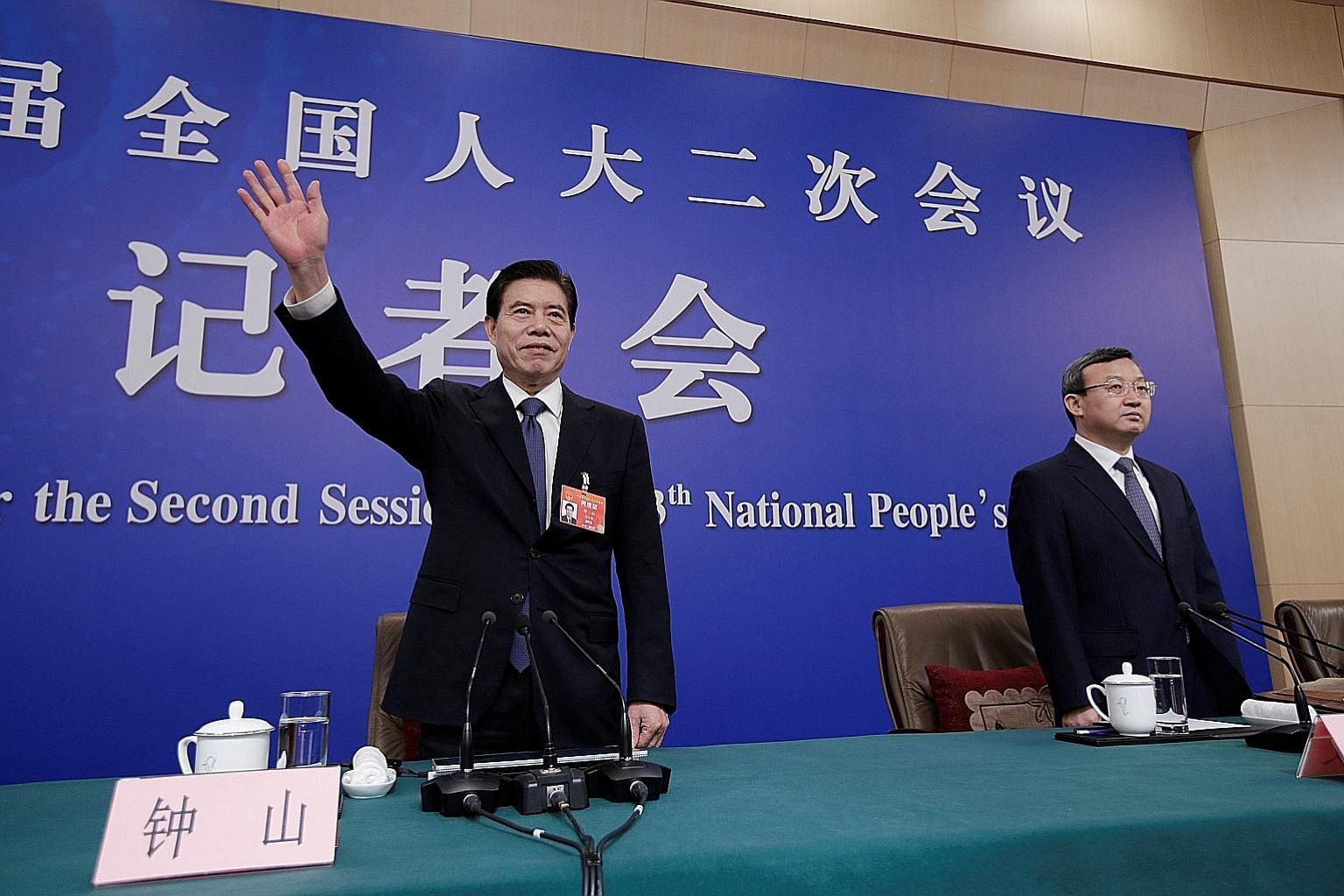 Chinese Commerce Minister Zhong Shan (left) and Vice-Minister Wang Shouwen at a news conference in Beijing yesterday. Mr Wang says Chinese and US negotiators are working on the final text of a trade agreement.