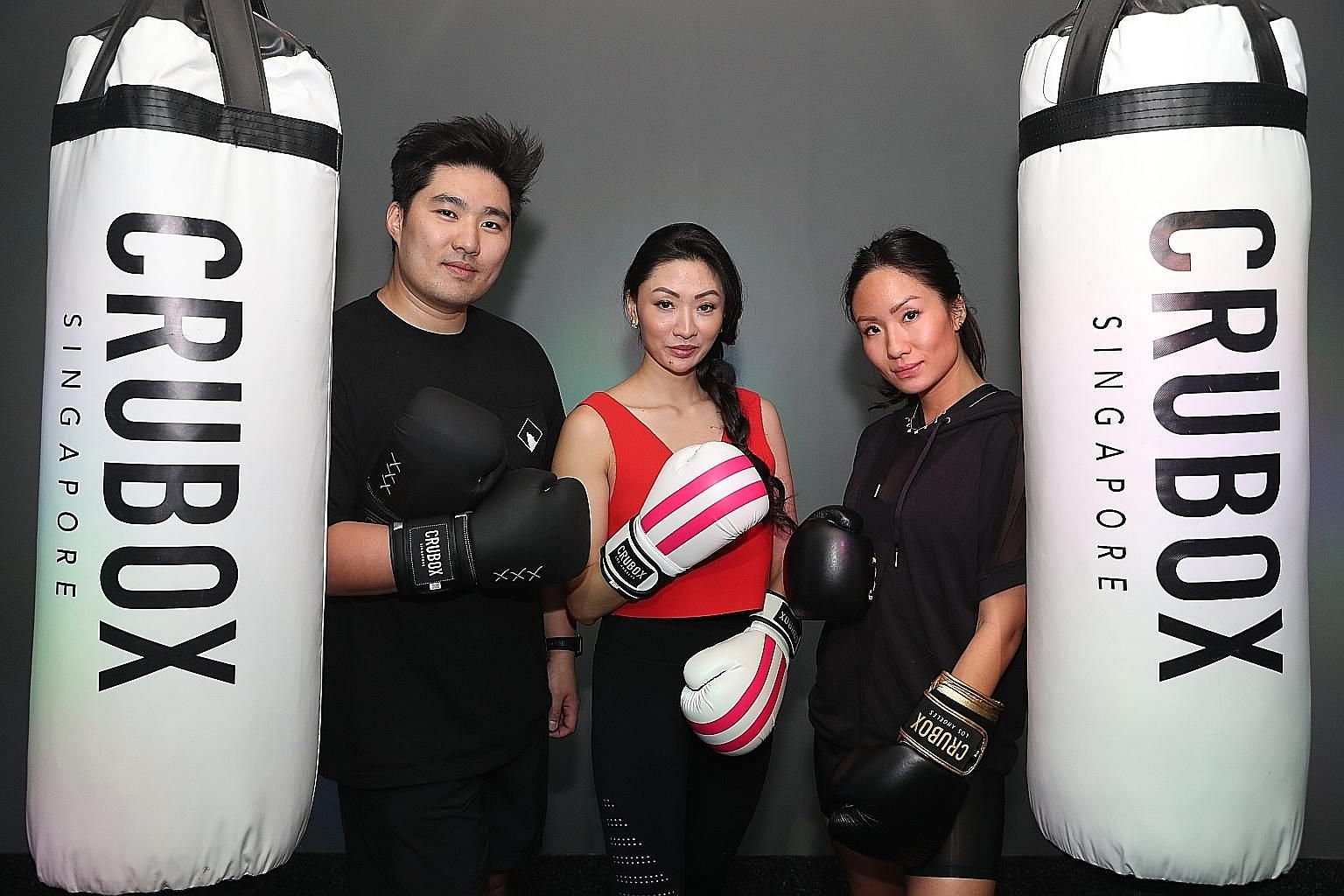 CruBox co-founders and siblings (from far left) Calvin Ding, Valerie Ding and Bebe Ding.