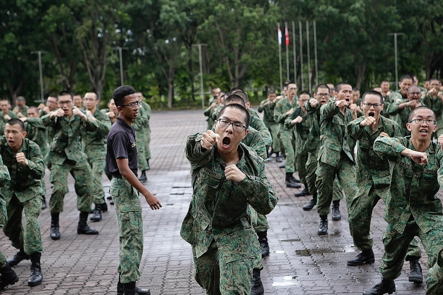 Recruits at the Basic Military Training Centre on Pulau Tekong last year. The latest batch of Singapore Armed Forces army recruits were unable to complete the required build-up training in time for the usual 24km graduation march after a two-week saf