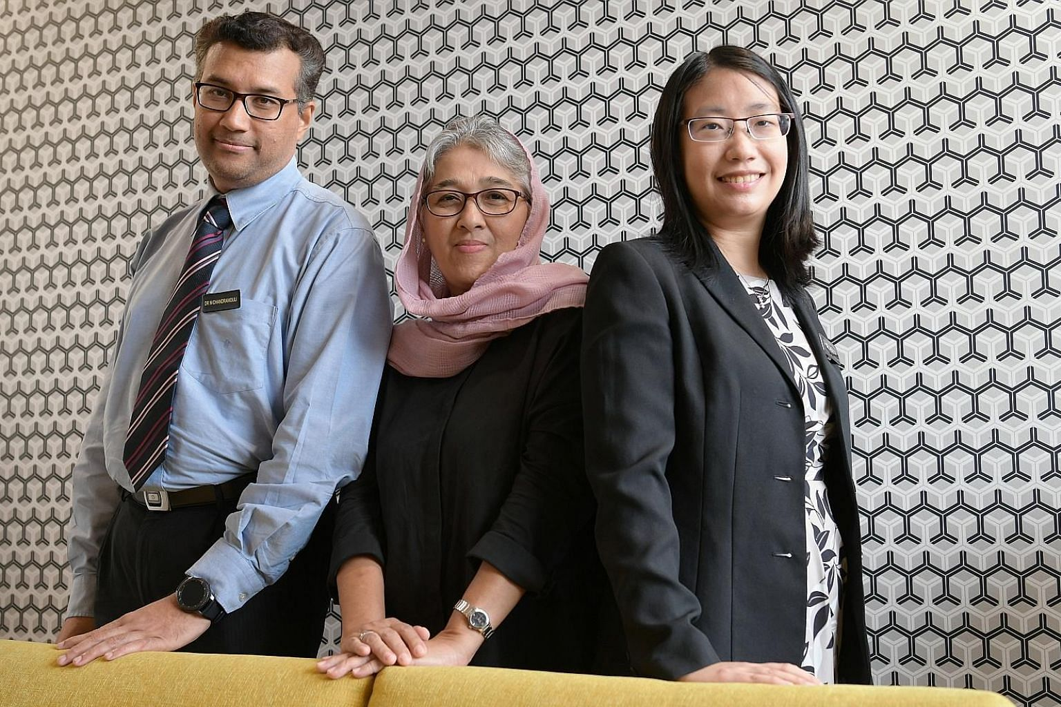 Madam Nasreen Ismail (centre) with haematologists Chandramouli Nagarajan and Chen Yunxin from Singapore General Hospital. Dr Chen is also the principal investigator of the clinical trial.