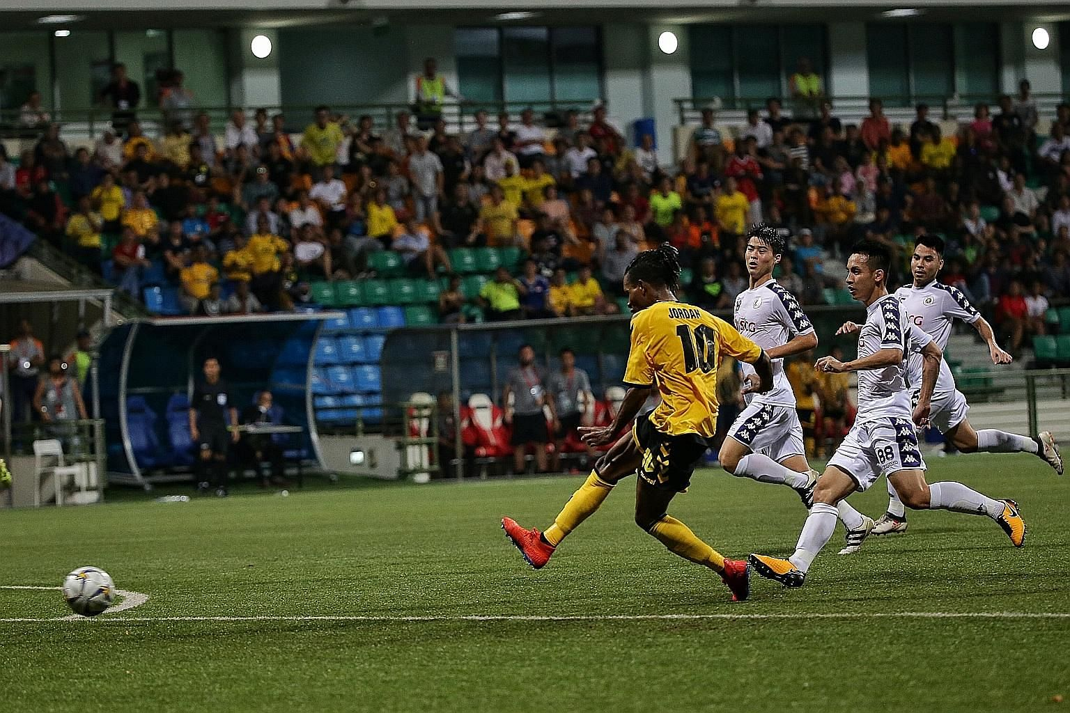 Tampines Rovers winger Jordan Webb scoring the equaliser during the 1-1 AFC Cup draw against Hanoi FC at Jalan Besar Stadium yesterday. The result meant that Hanoi stay top, ahead of the Stags on goal difference.