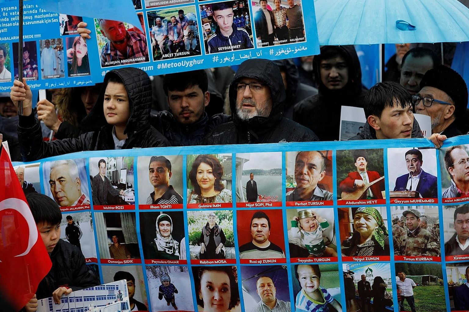 Ethnic Uighur protesters with portraits of their relatives said to be missing during a demonstration last month against China in Istanbul. The governor of Xinjiang, Mr Shohrat Zakir, yesterday dismissed Turkey's description of the region's re-educati
