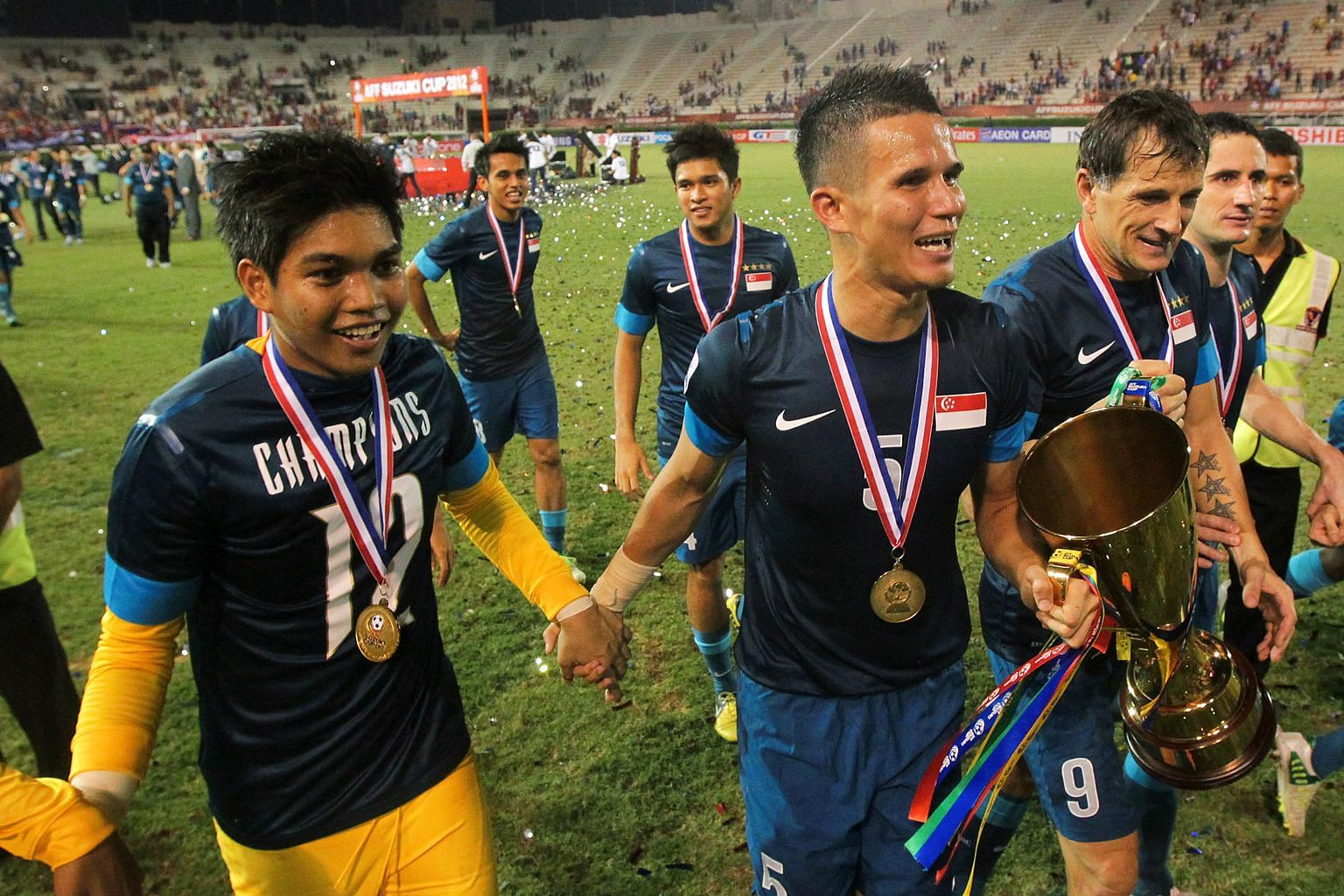 Baihakki Khaizan (centre) with (from left) Izwan Mahbud, Aleksandar Duric, Daniel Bennett and other players taking the lap of honour after beating Thailand 3-2 on aggregate in the final to win the 2012 Suzuki Cup. It was the fourth Asean Football Fed