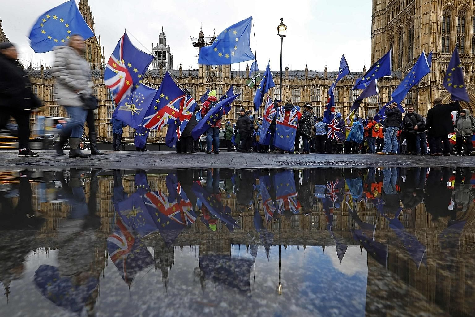 Anti-Brexit supporters outside Britain's Parliament on Tuesday - the day Prime Minister Theresa May's appeal to have an arrangement she negotiated with Europe ratified was voted down in the House of Commons.