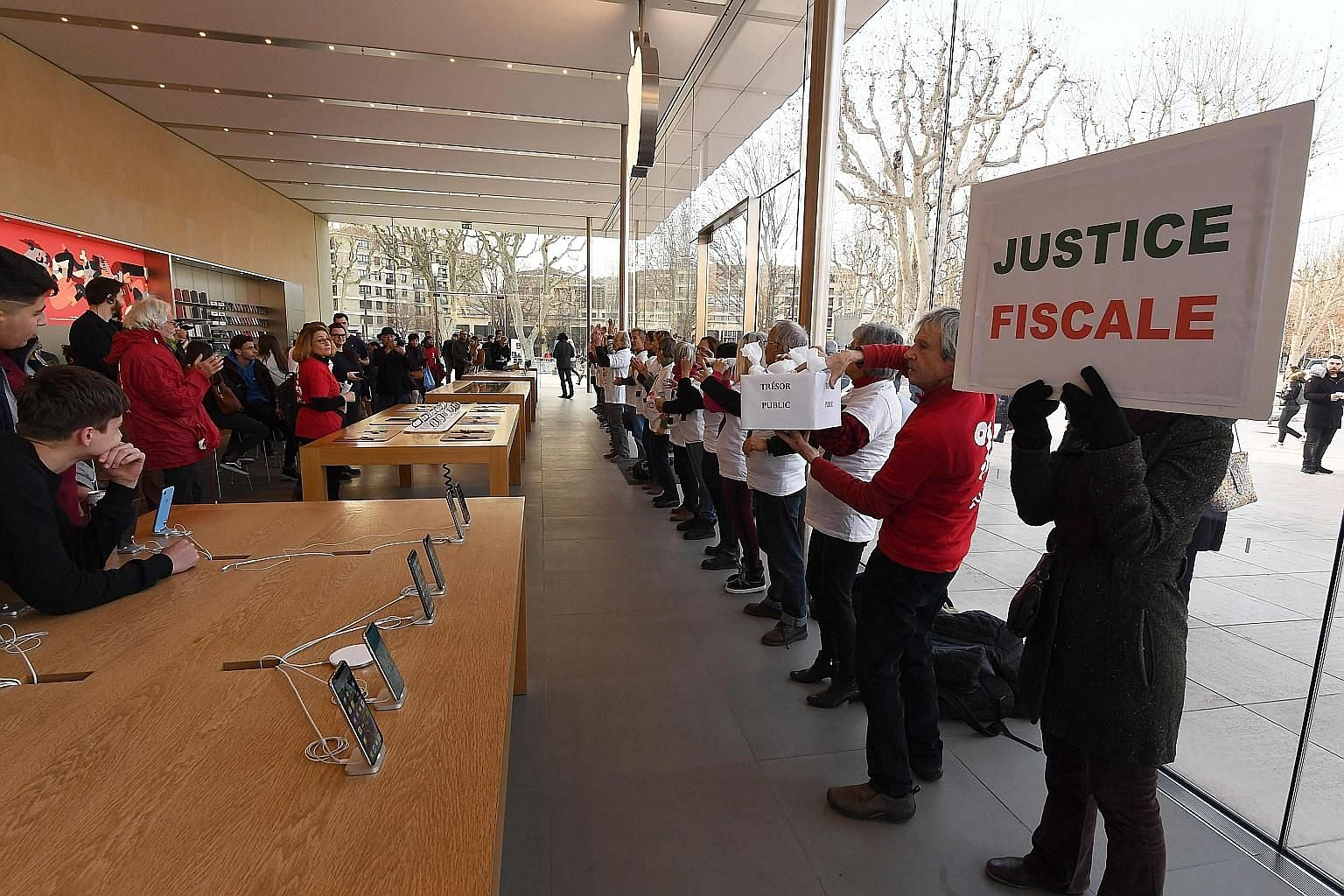 Activists taking part in a protest against tax evasion in an Apple store in Aix-en-Provence, southern France, in January. Under the digital tax proposal that is awaiting Parliament's approval, 3 per cent of a digital company's turnover in France must