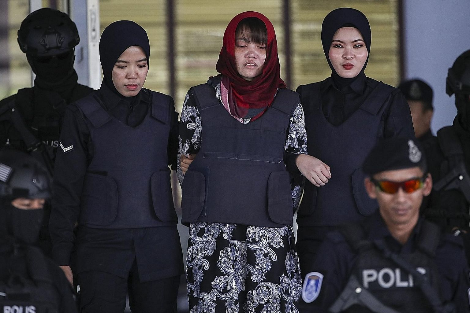 Vietnamese Doan Thi Huong being escorted out of the Shah Alam High Court yesterday. Huong and Indonesian Siti Aisyah were both charged over the murder of North Korean leader Kim Jong Un's half-brother in 2017, but Jakarta lobbied successfully for cha
