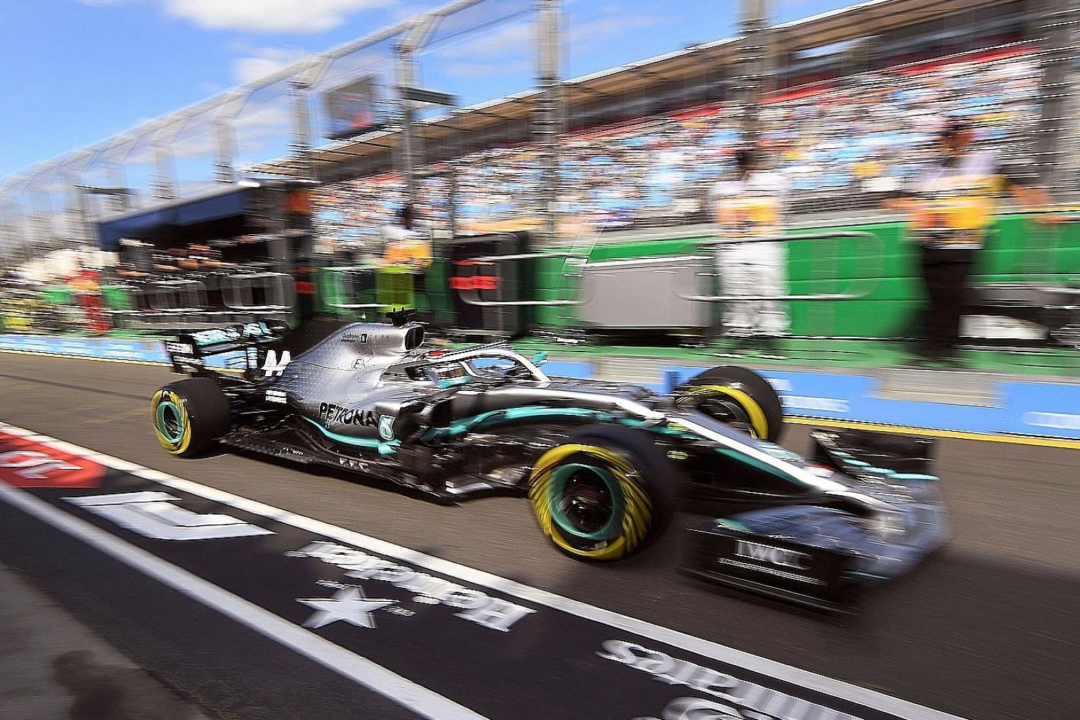 Mercedes' five-time world champion Lewis Hamilton making his way out of the pits during first practice at the Australian Grand Prix in Melbourne yesterday.