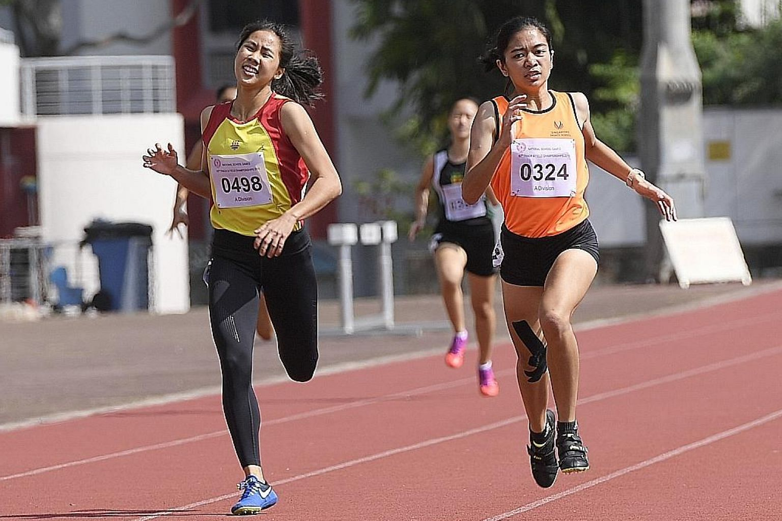 Diane Pragasam from the Singapore Sports School sprinting to the finish line to hold off Hwa Chong Institution's Amanda Woo to win the A Division 400m in a personal-best 61.00 seconds at Choa Chu Kang Stadium yesterday.