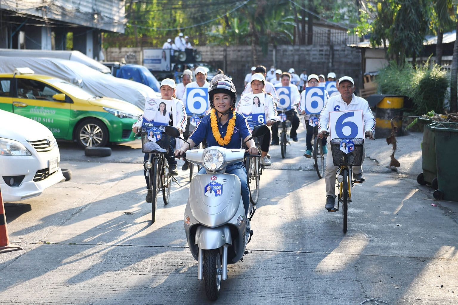 Parliamentary candidate Korranit Ngamsukonratana of the army-aligned Palang Pracharath Party leading a motorcade during a campaign in Klongtoey district in Bangkok on Thursday. This is the first time that Thailand's military has formed a political pa