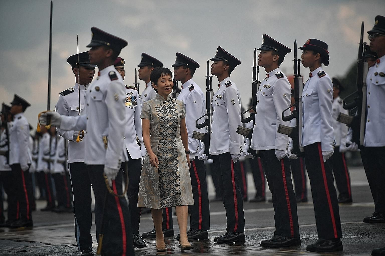 """Minister for Culture, Community and Youth Grace Fu at the parade at Safti Military Institute yesterday. She urged the 220 newly commissioned officers from the army, navy and air force to """"lead by example and drive a culture of safety on the ground""""."""