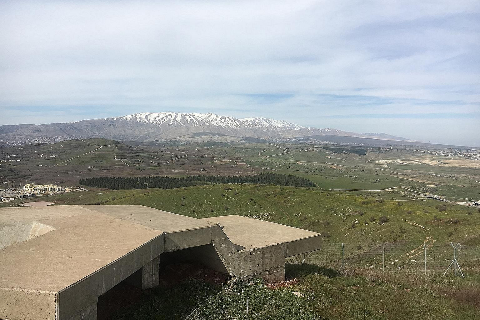 "A view from an Israeli army position on Mount Hermon and the Syrian border in the Golan Heights. Israeli security sources told ST the Hizbollah militia decided last year to form a special unit called the ""Golan File"" with the goal of recruiting Syria"