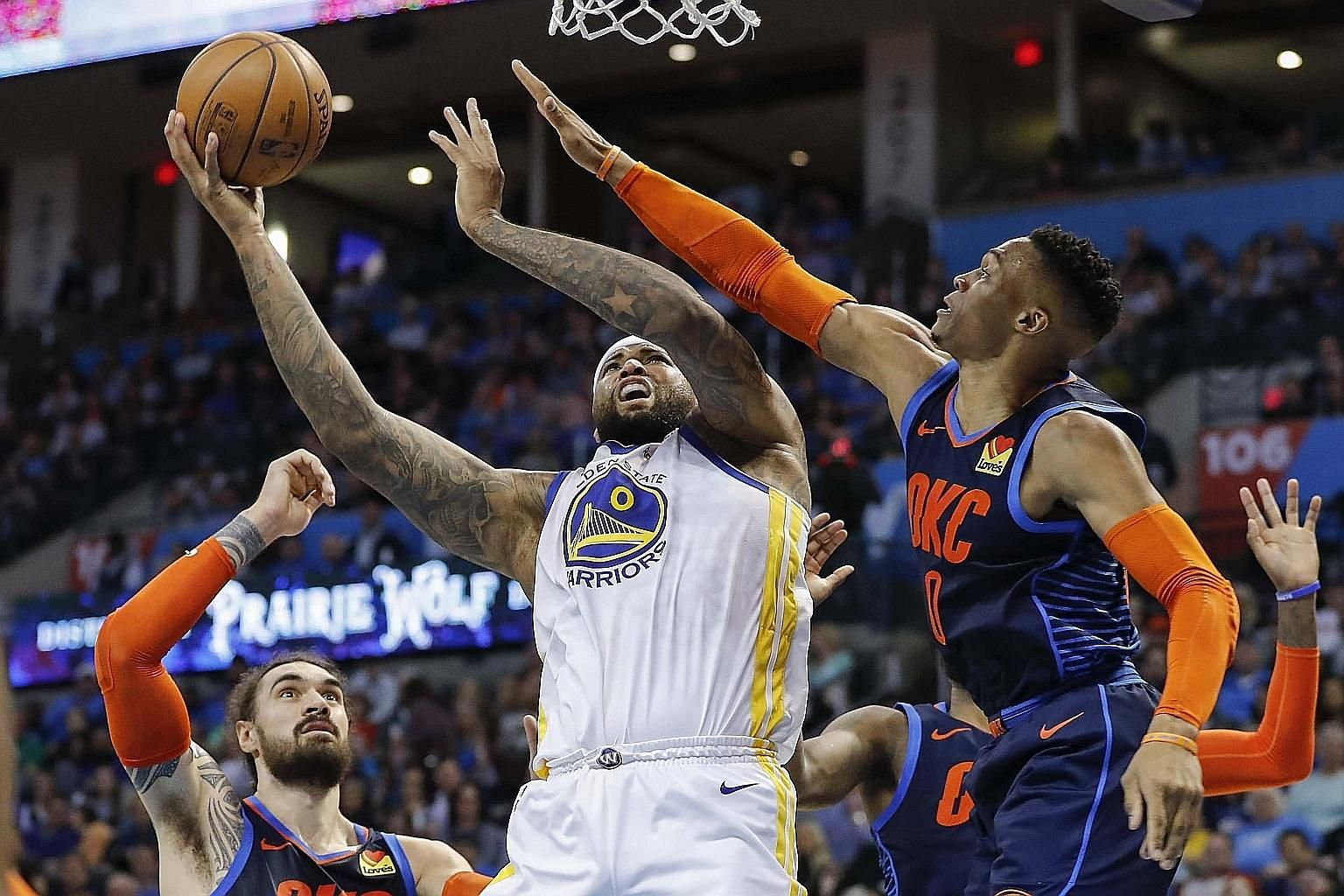 Golden State centre DeMarcus Cousins going up for a basket as Oklahoma City guard Russell Westbrook defended during the first half at the Chesapeake Energy Arena on Saturday. The Warriors won 110-88.