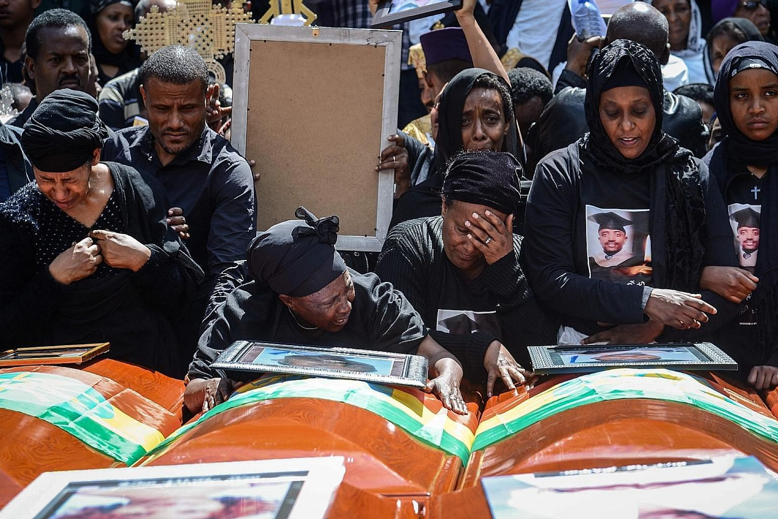 Mourners at a burial service in Addis Ababa, Ethiopia, on Sunday for victims of the March 10 plane crash. Investigations into the crash are ongoing but early evidence has pointed to a problem with the flight stabilisation system designed to prevent s