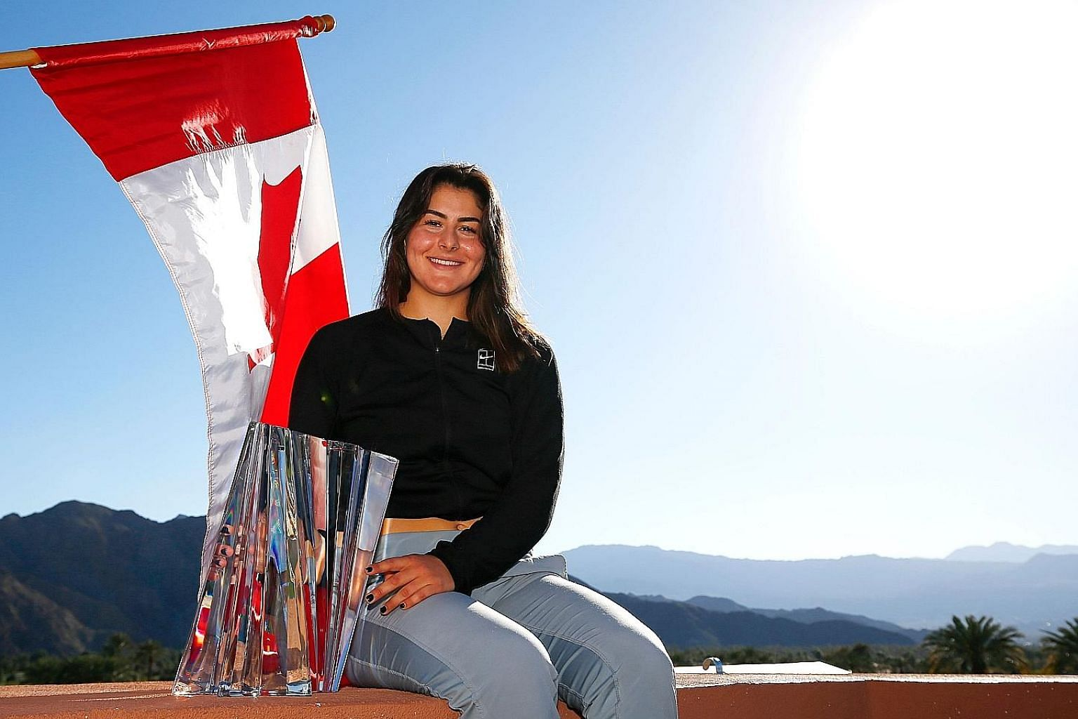 Canadian Bianca Andreescu, 18, is the first wild card to win the prestigious WTA Indian Wells trophy.