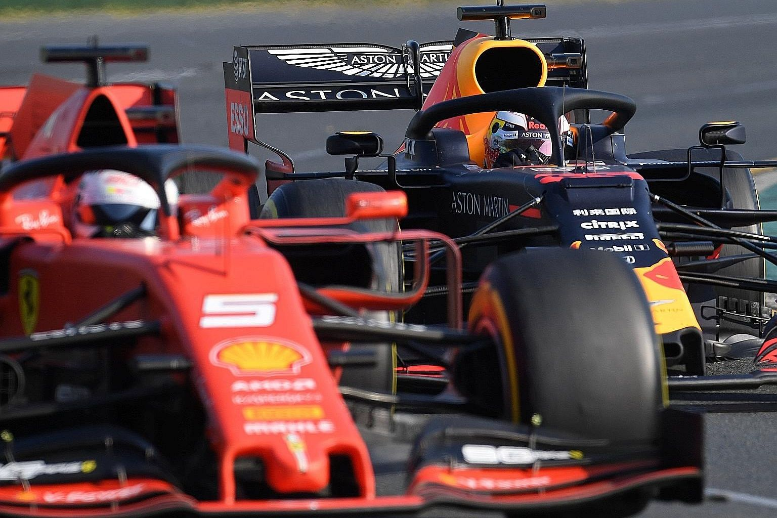Red Bull's Max Verstappen chasing down Ferrari's Sebastian Vettel before catching him on Lap 30 and holding on for a podium place.