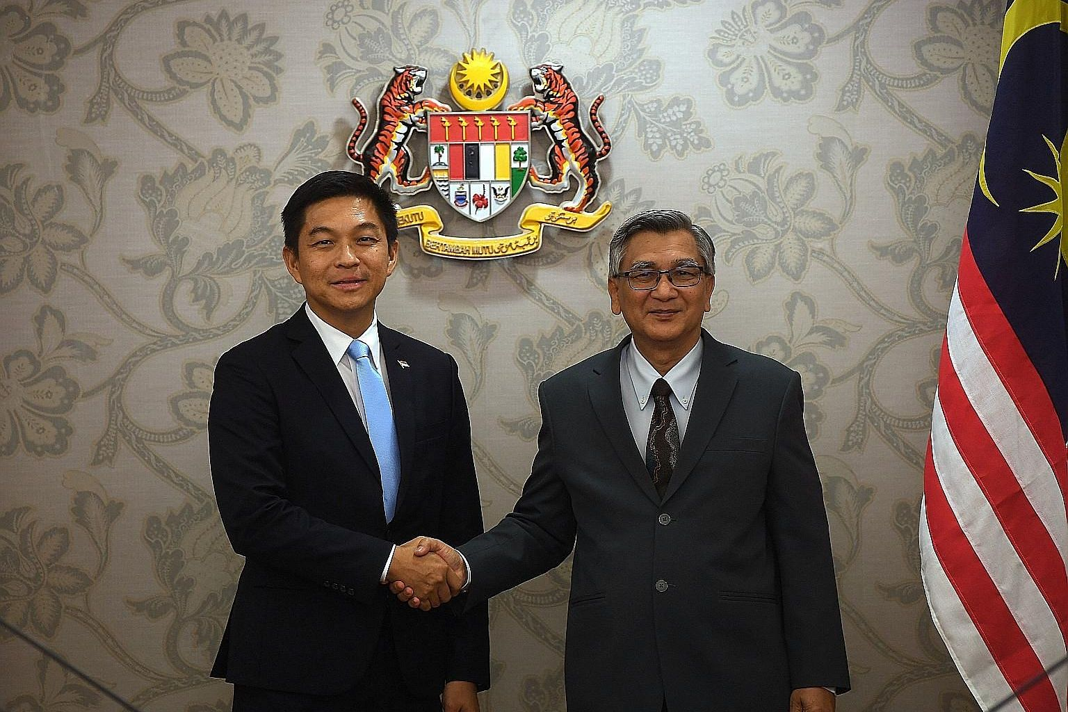 Singapore's Speaker of Parliament Tan Chuan-Jin with his Malaysian counterpart Mohamad Ariff Md Yusof yesterday. As part of his visit, Mr Tan observed a session of the Malaysian Parliament.