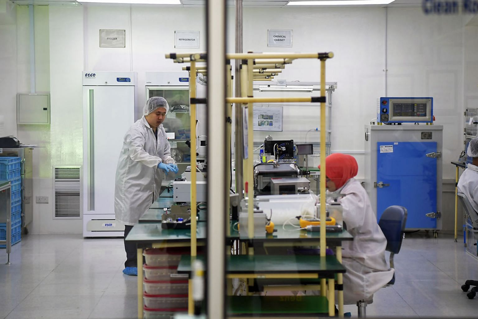 Employees working in the assembly department of a firm which designs and manufactures high-value medical devices and lab equipment. A report released by Euromonitor International revealed that an overwhelming number of respondents felt that growth wo