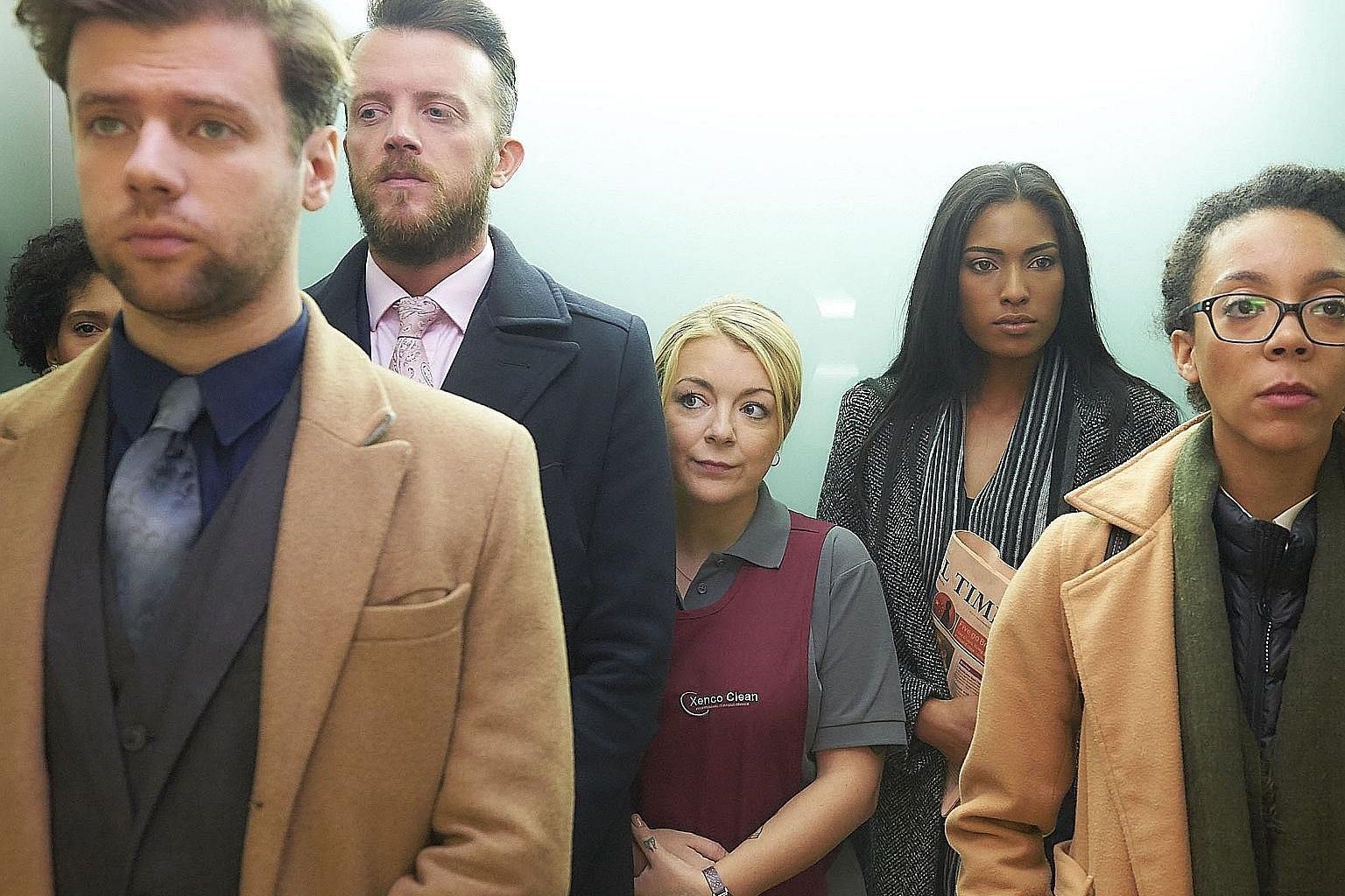 Sheridan Smith (in red apron) plays a single mother with a gambling addiction who tries her hand at insider trading.