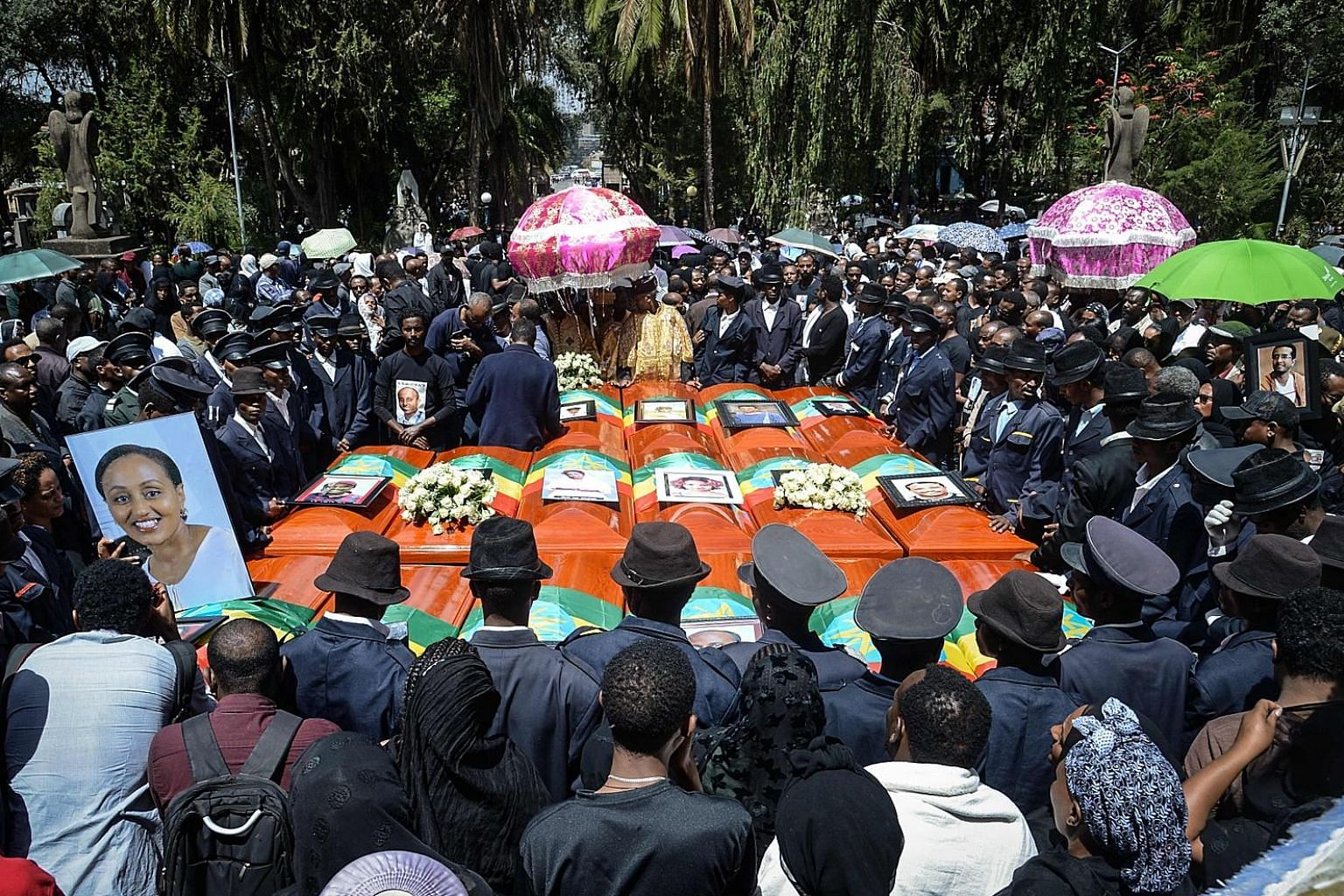 Mourners during the mass funeral. Boeing's plans to get its B-737 Max jets back in the sky after they were grounded worldwide suffered a setback after Europe and Canada said they would seek their own safety guarantees.