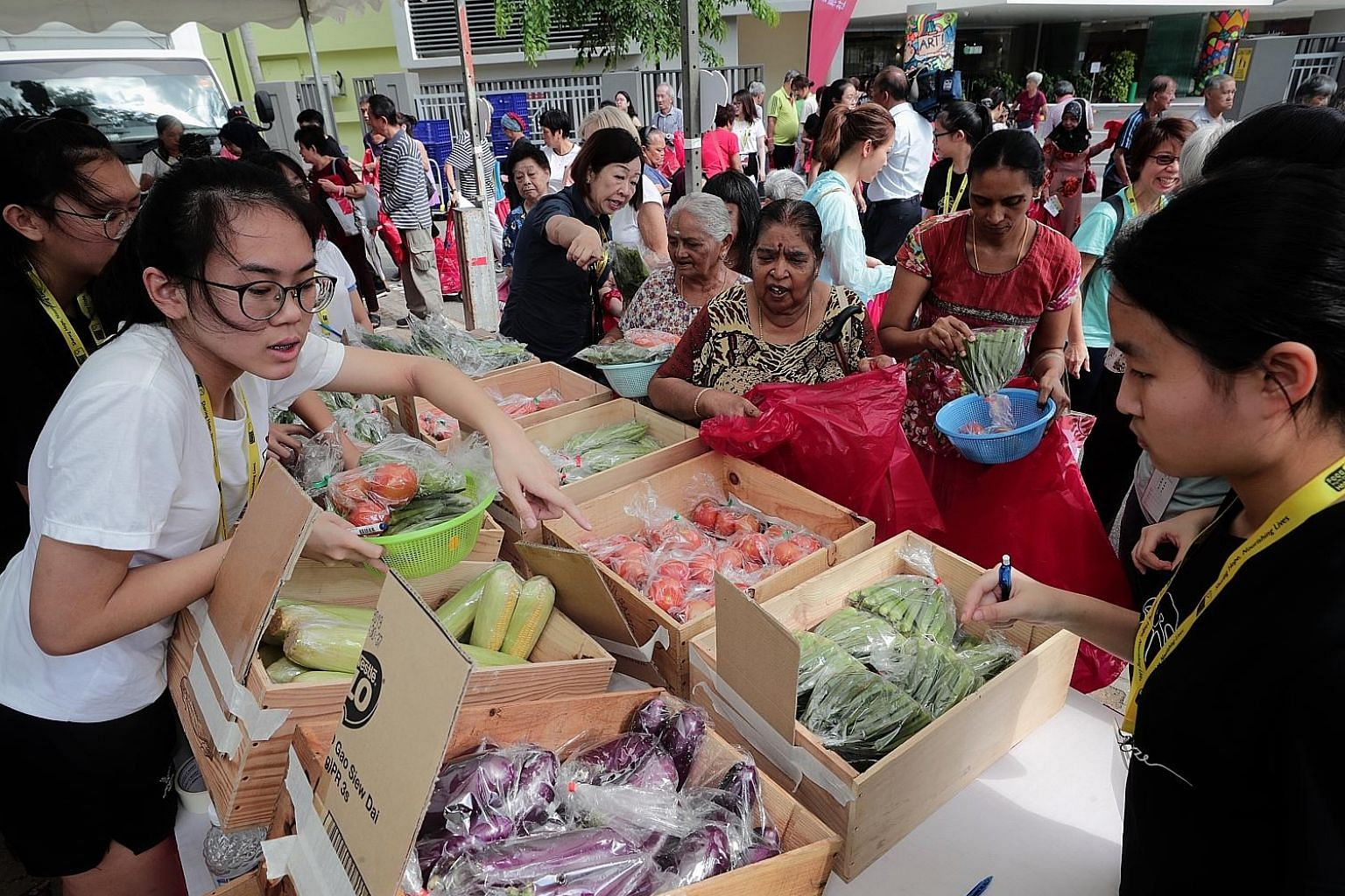 Madam Siti Aidah Abdullah (above) was one of the 500 beneficiaries at yesterday's charity pop-up market, which allowed needy beneficiaries to shop for $50 worth of fresh produce.