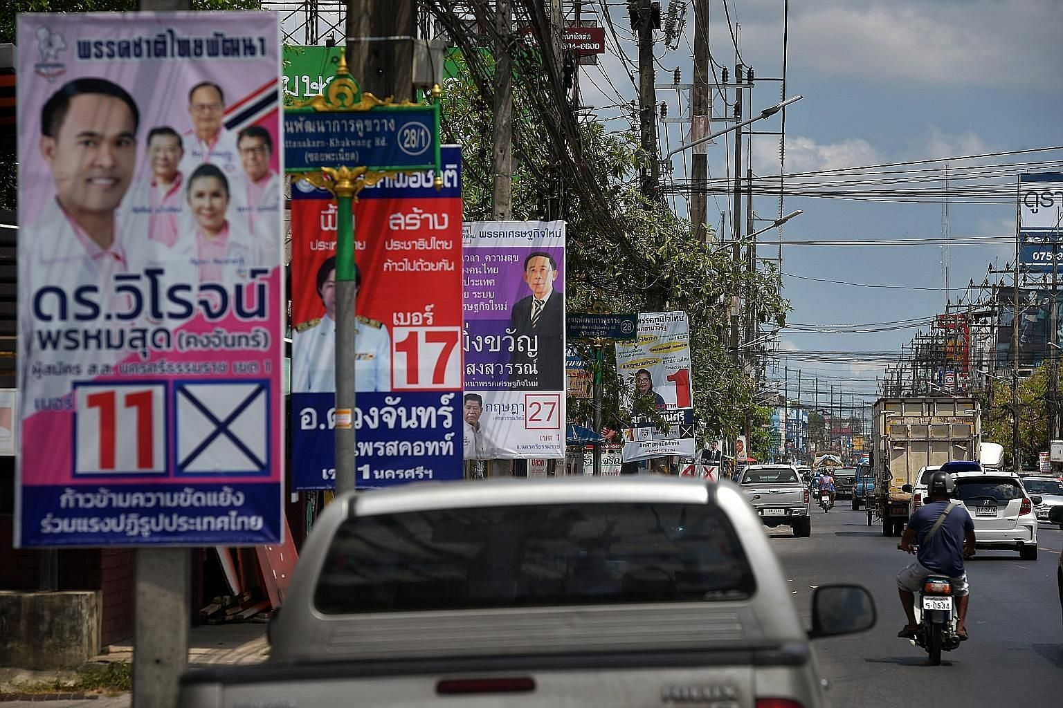 Election posters put up along the streets of Nakhon Si Thammarat, southern Thailand, ahead of the polls this Sunday. The general election is set to see an exceptionally high voter turnout, higher than the 75 per cent in the 2011 general election, bec