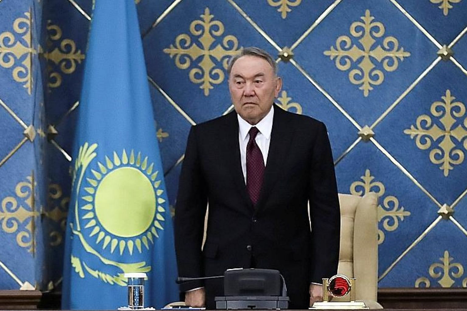 Acting President of Kazakhstan Kassym-Jomart Tokayev (bottom) and chairman of the Lower House of Parliament Nurlan Nigmatulin (centre) applauding former president Nursultan Nazarbayev (top) during a joint session of the Houses of Parliament yesterday