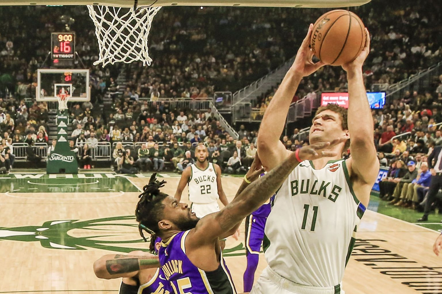 Milwaukee Bucks centre Brook Lopez shooting over Los Angeles Lakers guard Reggie Bullock during their 115-101 NBA win on Tuesday. The Bucks have already clinched a play-off spot while the Lakers are set to miss out.