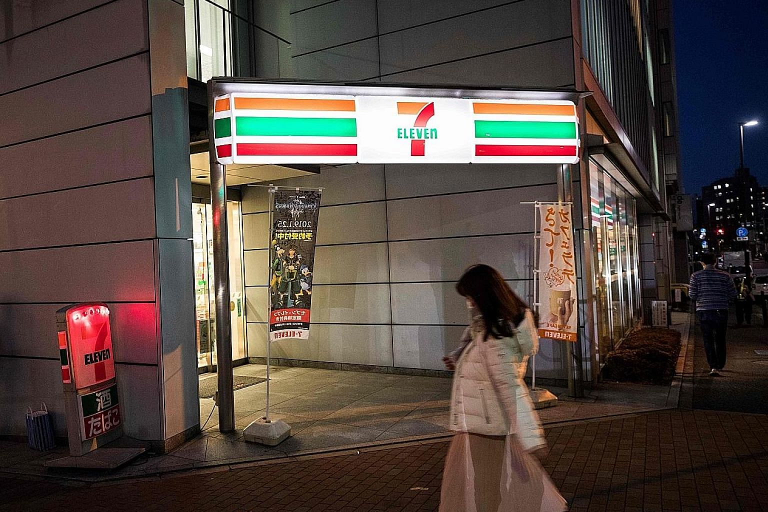 A 7-Eleven convenience store in Tokyo. Store owners are finding it increasingly hard to hire enough workers. Many owners say they have to work long hours themselves to keep their stores open 24 hours.
