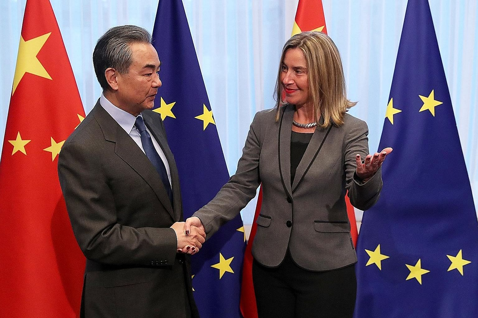 Chinese Foreign Minister Wang Yi being welcomed by Ms Federica Mogherini, the European Union's foreign policy chief, ahead of a meeting in Brussels on Monday. Mr Wang said earlier this month that relations between China and Europe were in good shape,
