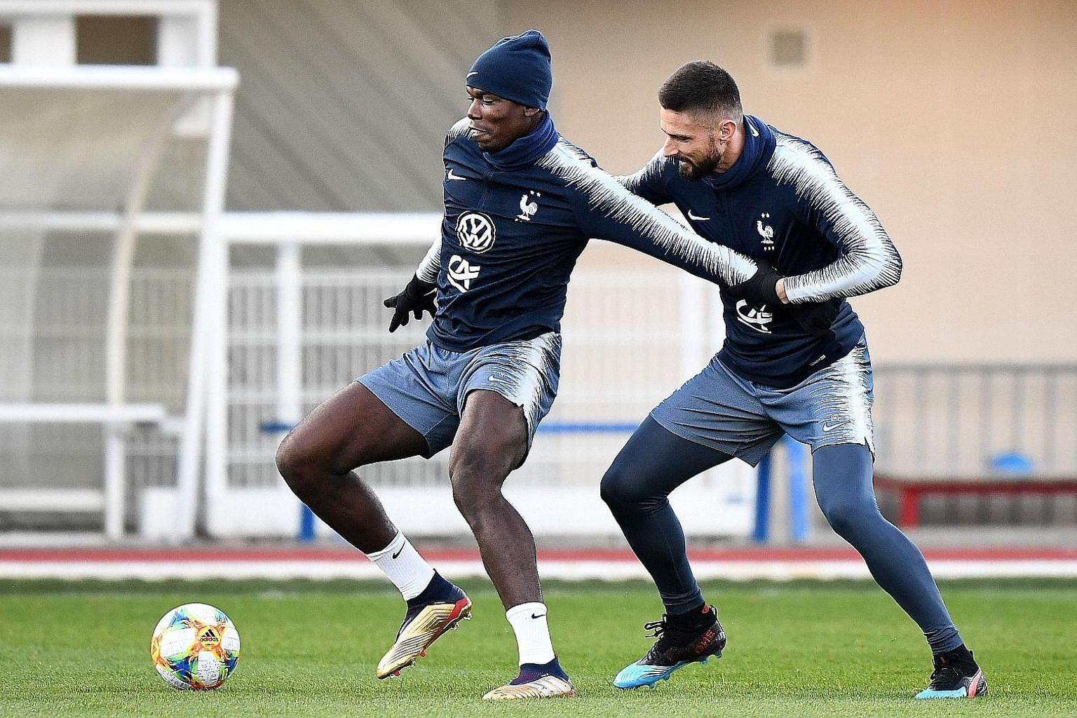 France midfielder Paul Pogba is closely marked by teammate Olivier Giroud during a training session on Tuesday as they prepare for their upcoming Euro 2020 qualifiers against Moldova and Iceland.