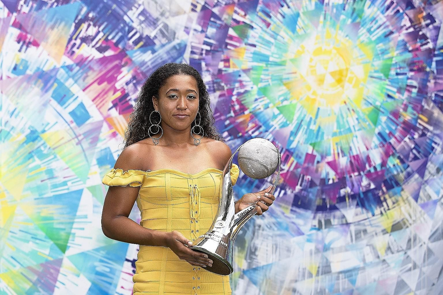 Japan's Naomi Osaka holding the WTA world No. 1 trophy during an event at the Miami Open on Wednesday.